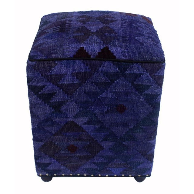 Chic handmade ottoman crafted using wood and upholstered using hand-woven kilim wool rug is a multi-purpose fashion pouf...