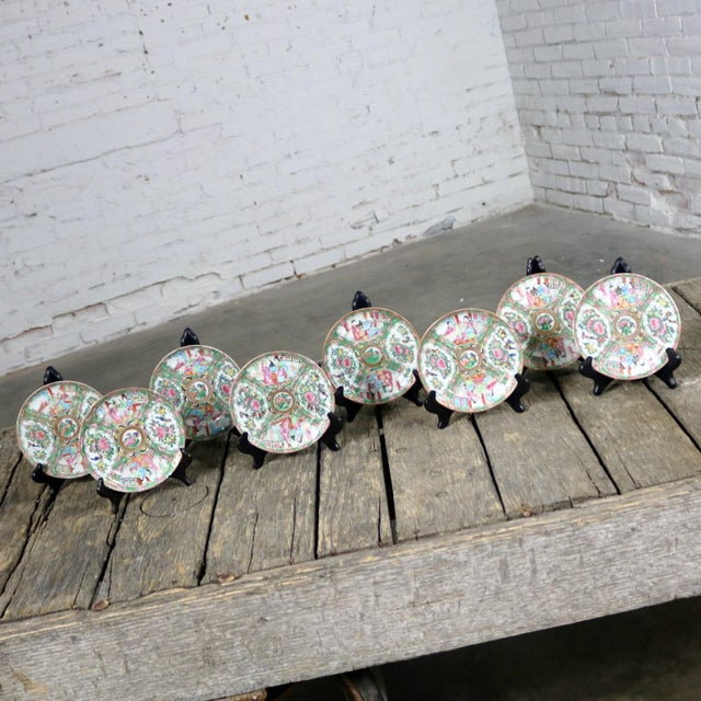 Wonderful set of eight antique Chinese Qing Rose Medallion porcelain 6-inch plates with a cupped or curved lip. They all...