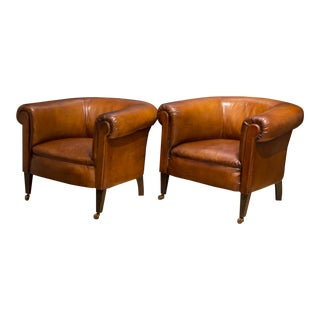 Pair of Sheep Hide French Round Club Chairs With Bakelite and Brass Casters C.1930-1950 For Sale