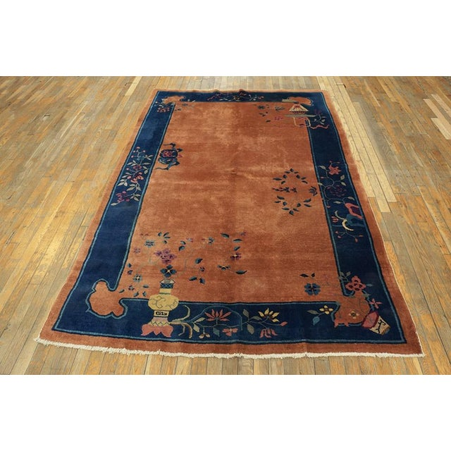 "This is a Chinese art wool rug from China 1920. The size is 5'x7'10"". The colors are orange, blue, light yellow, purple,..."