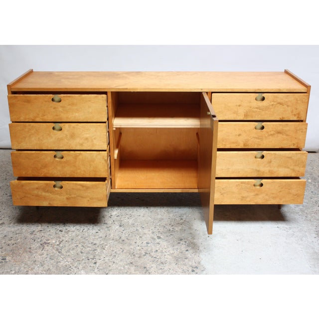 This 1950s Swedish maple sideboard / chest by Edmond Spence is composed of eight drawers (four on each side) divided by a...