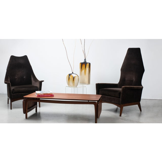 1960s dramatic his and hers lounge chairs attributed to Adrian Pearsall, upholstered in chocolate brown velvet. Sleek...