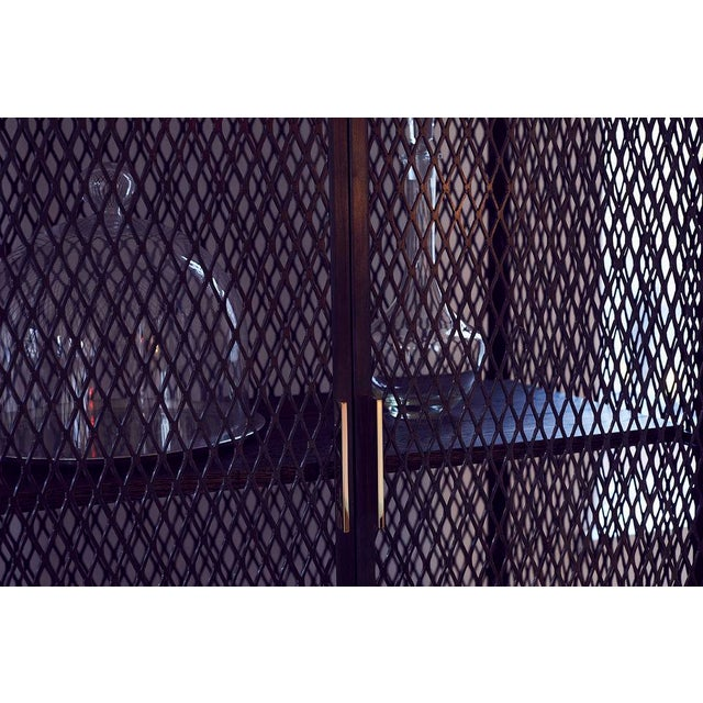 "By Pelle Starting Price: $7,590 Specifications: 36"" w x 21"" d x 84"" h Available Finish: Blackened Perforated / Expanded..."