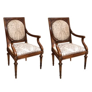 An Exquisite and Large-Scaled Pair of Italian Neoclassical Carved Walnut Upholstered Arm Chairs For Sale