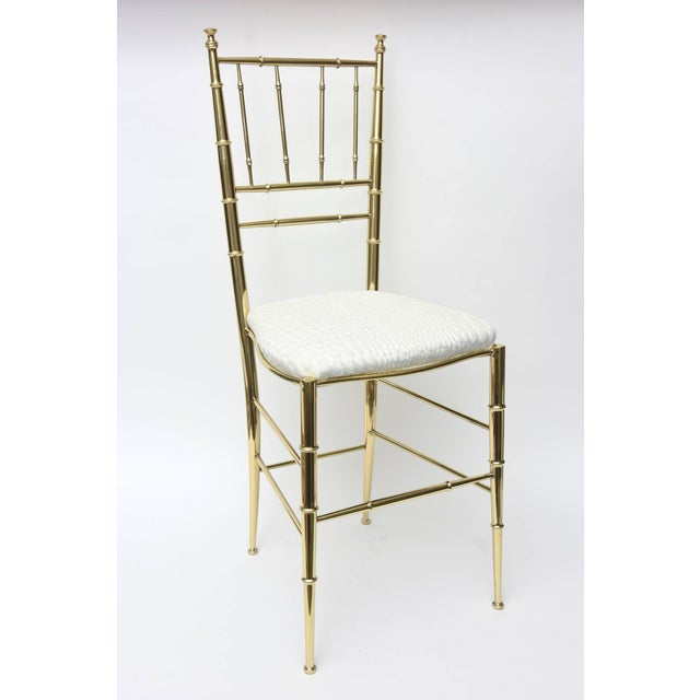This lovely polished brass Italian midcentury Chiavari side chair has faux bamboo elements. It has been just re-...