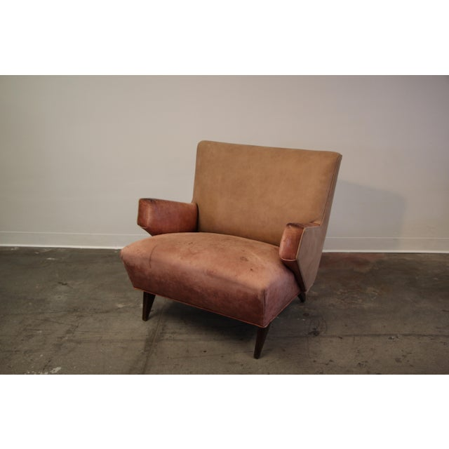 An early lounge chair by Jens Risom manufactured by Knoll International, circa 1950s. This specific chair was custom piece...