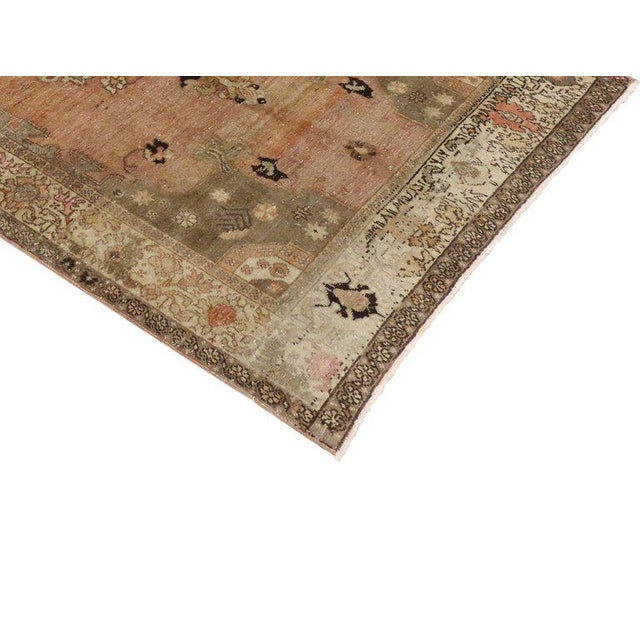 Distressed vintage hand-knotted wool Turkish Sivas rug with Modern Industrial style. Features an ornate center medallion...