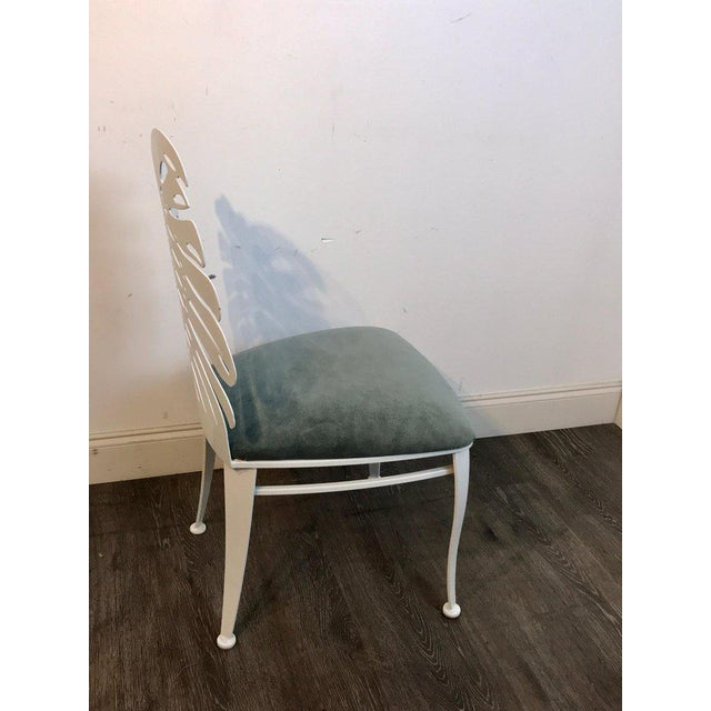 Six 1970s wrought iron palmette chairs, restored, each one with a pierced backrest, and upholstered seat. Newly powder...