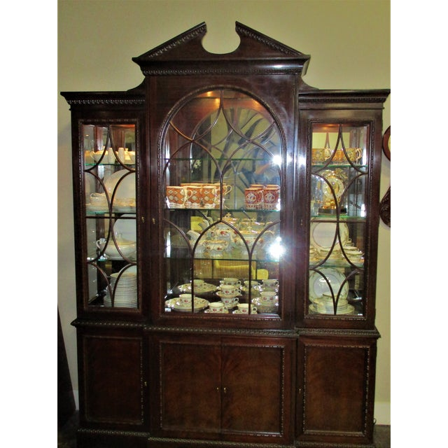 Beautiful details abound on this mahogany covered china cabinet with burlwood veneer. Includes 3 levels of lighting for...