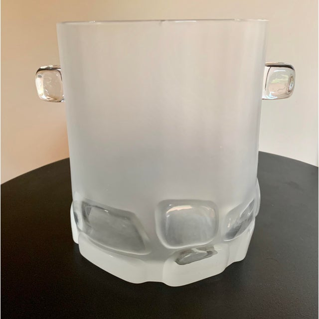 Unique early 20th century brutalist hand cast ice bucket. Amazing five-pound piece of silkly smooth frosted glass with an...