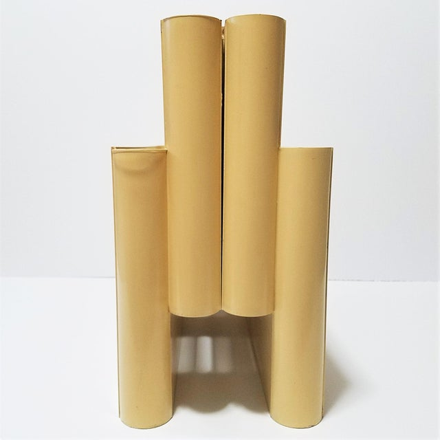 Mid Century, ivory-colored, plastic magazine rack designed by Giotto Stoppino for Kartell. Kartell, the Italian design...