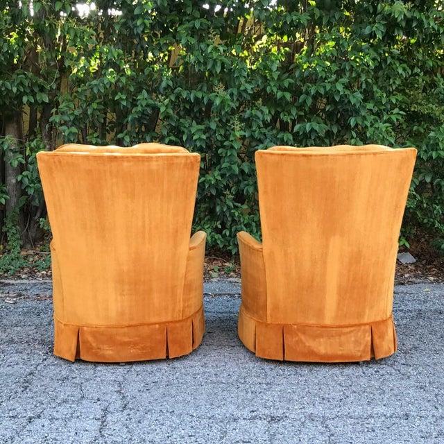 Pair of retro orange velvet swivel rockers. Tufted backs. Very comfortable. Excellent pop of color.
