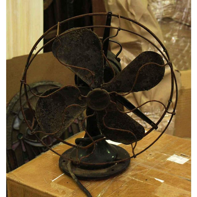 Heavy vintage fan once used in early offices and homes. This is an older model fan which needs some restoration.
