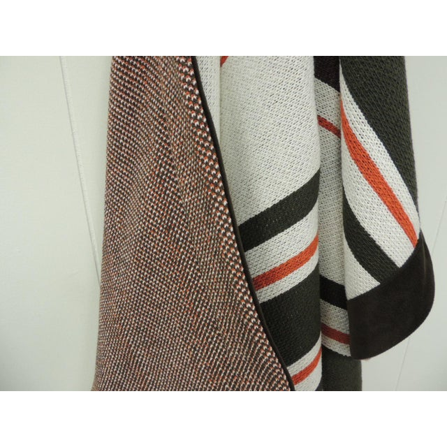 Large brown and orange stripes Allessandra Branca throw with faux suede trim all around and reversible red, brown and...