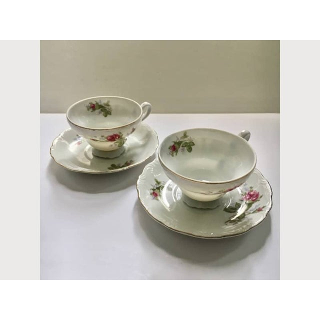 Pair of Moss Rose Pattern Porcelain Tea Cups and Saucers. Scalloped edges. Gold trim. Circa 1950. Elegant. Glowing....