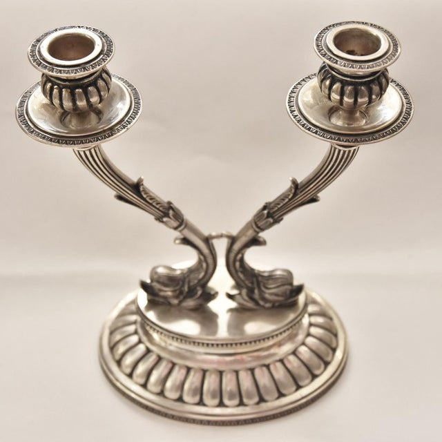 A preciously decor pair of 18th Century silver candle holders, Made in Italy