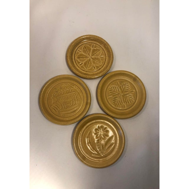Set of 4 Pigeon Forge Pottery Old Butter-mold Print Coasters-Ash Trays. Pigeon Forge Pottery was in Tennessee and was in...