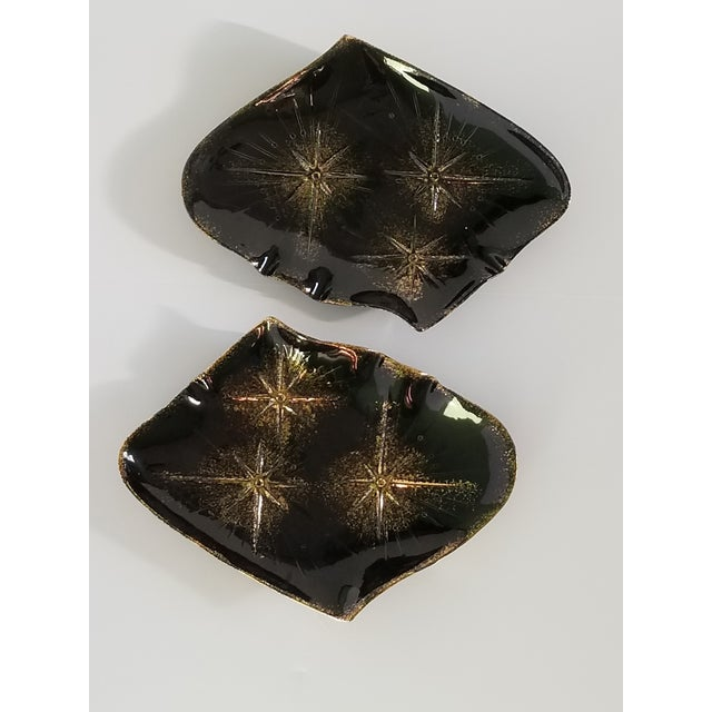 """By California Pottery """"Calif. Orig 742"""",mid-century modern abstract shaped black ceramic serving platters with star motif..."""