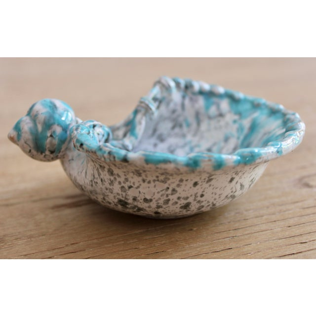 A stunning turquoise blue, white, and charcoal seashell dish, made in Italy. This is such a lovely piece that is the work...