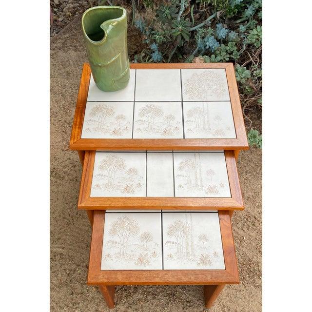 "Set of 3 vintage Danish Modern teak tile top nesting tables by Trioh. Largest table is 14.5""x20.5""x17""h. The whole set..."