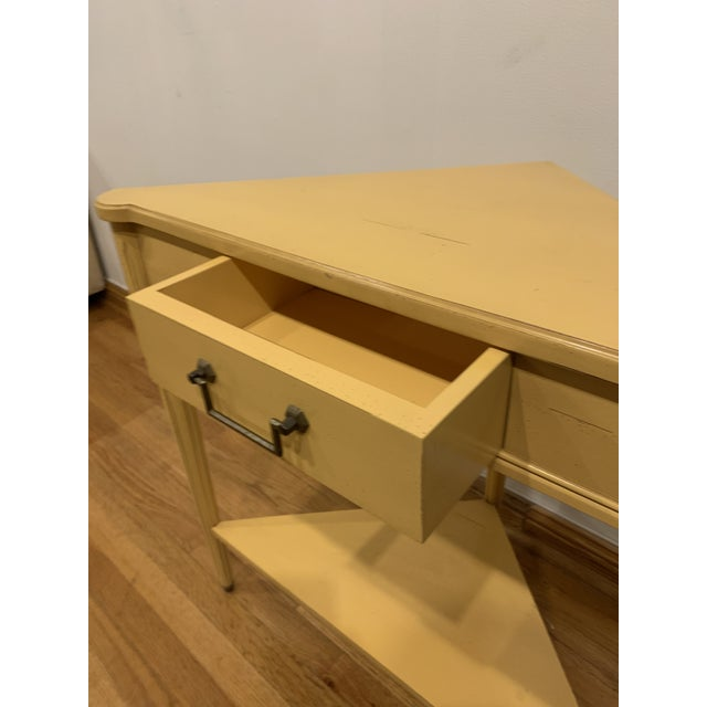"Grange corner table on yellow painted finish. Sides are 16"" front to back. One drawer."