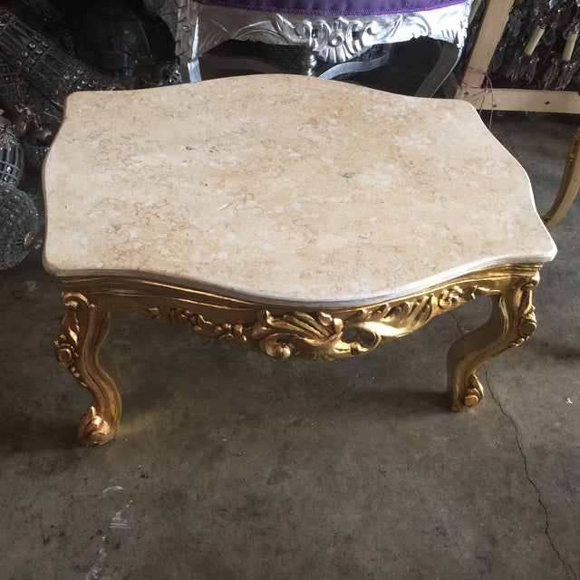 A beautiful neoclassical style coffee table with marble top and gilded wood. White glove delivery available. Please send...