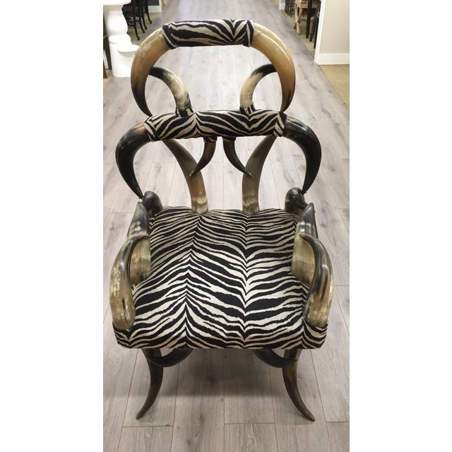Unusual zebra fabric horn chair.