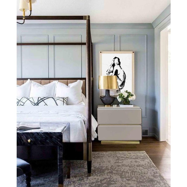 A pair of vintage nightstands or end tables by Lane Furniture Company, lacquered in gray, which nicely complements the...