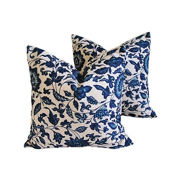 Pair of pillows in a contemporary printed linen-and-cotton blend fabric depicting a deep indigo blue floral design. Taupe...