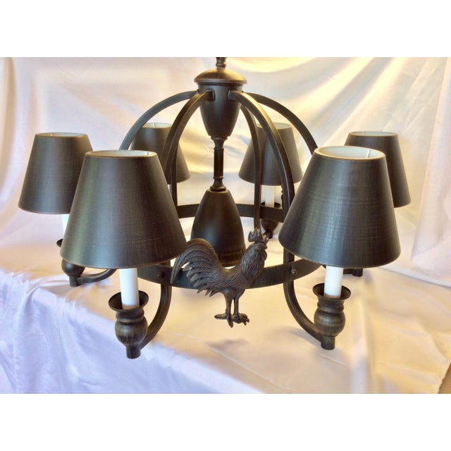 This wonderfully understated and truly unique six light chandelier is done in a fabulous rustic finish, reminiscent of a...