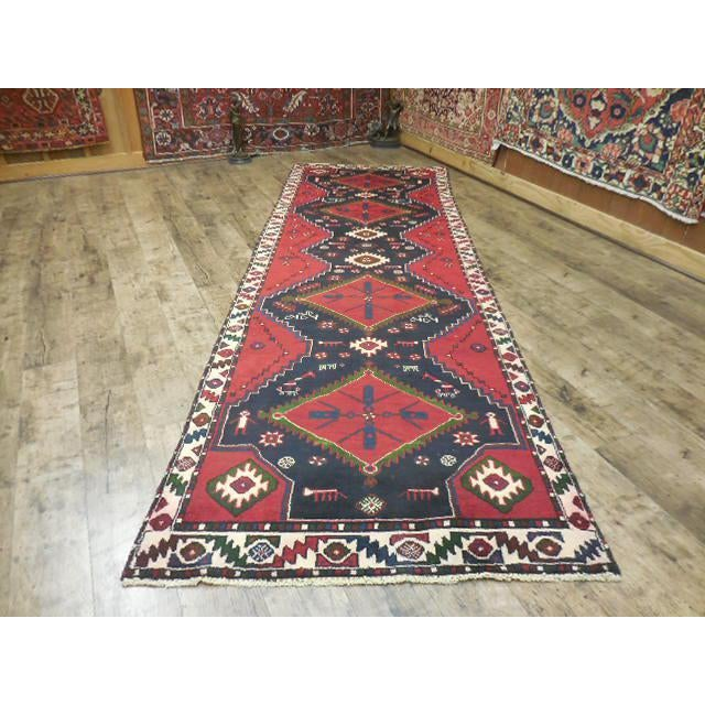 Vintage Persian Kilim runner with tribal boho chic styling, hand-knotted wool, professionally cleaned.