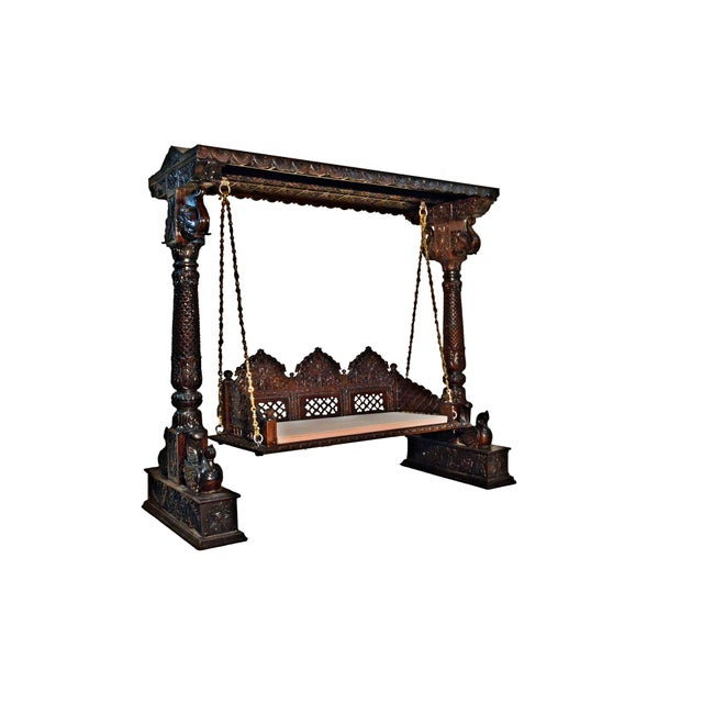 This Royal Indian Jhula Swing is exquisitely handcrafted by Skilled Indian Craftsman. This crafted wooden swing is a...