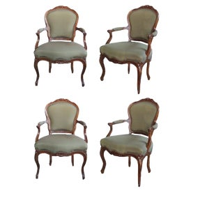 An Well-Carved Set of 4 French Louis XV Style Walnut Open Armchairs For Sale