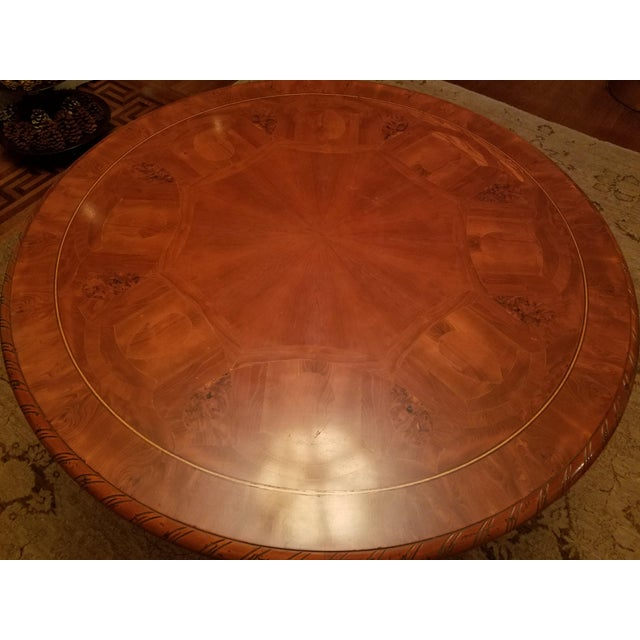 This gorgeous table is an Ebanista table with intricate inlay and carved apron and center pedestal.