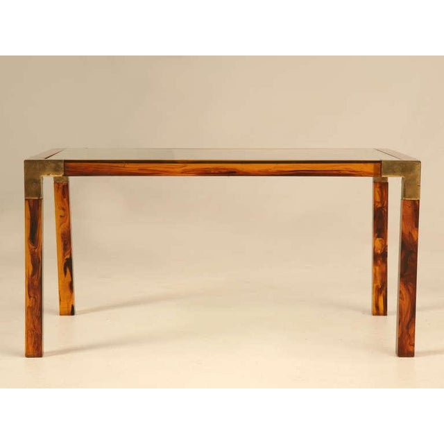 Circa 1960's faux tortoise shell acrylic and brass petite French coffee table. This has to be one of the most unusual and...