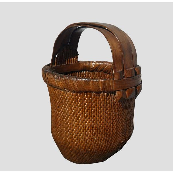In well-aged brown color with 3 bent handles, this beautifully hand woven basket was used to carry fresh vegetables from...