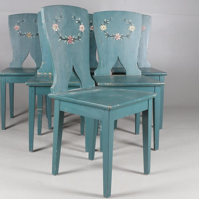 "Beautiful design on these Swedish antique chairs in ""Allmoge"" design. Original paint."
