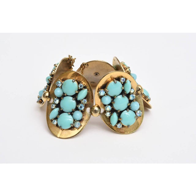 This beautiful Elsa Schiaparelli bracelet has 5-Oval connected discs with faux turquoise & rhinestone clusters against...