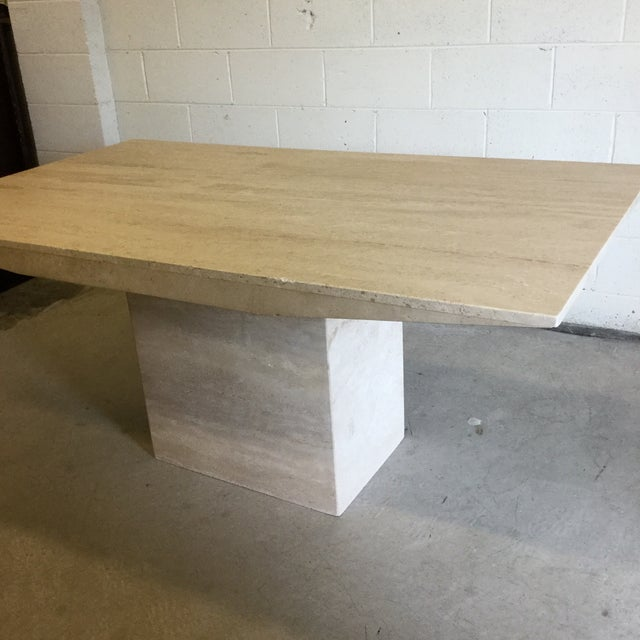 Drop dead gorgeous, travertine dining table or writing desk. Not a thing wrong with it. Easy to move if you are strong....