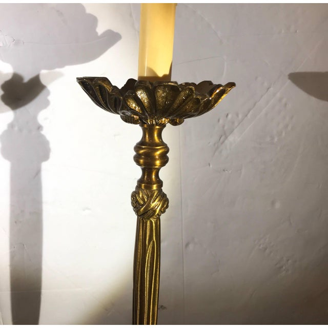 Elegant pair of cast brass tall buffet or console lamps with silk shantung scalloped shades. The finish is an aged gilt...