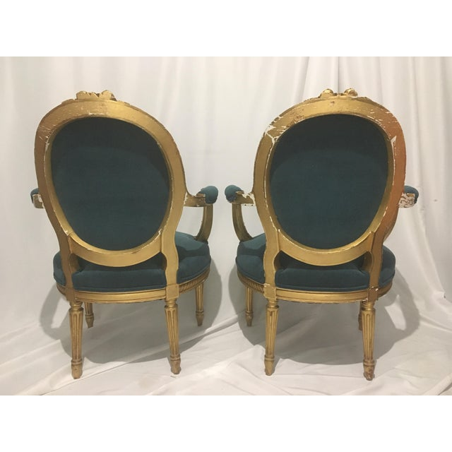 New upholstered pair of antique giltwood Louis XVI chairs in a peacock velvet fabric. Chairs have original horse hair...
