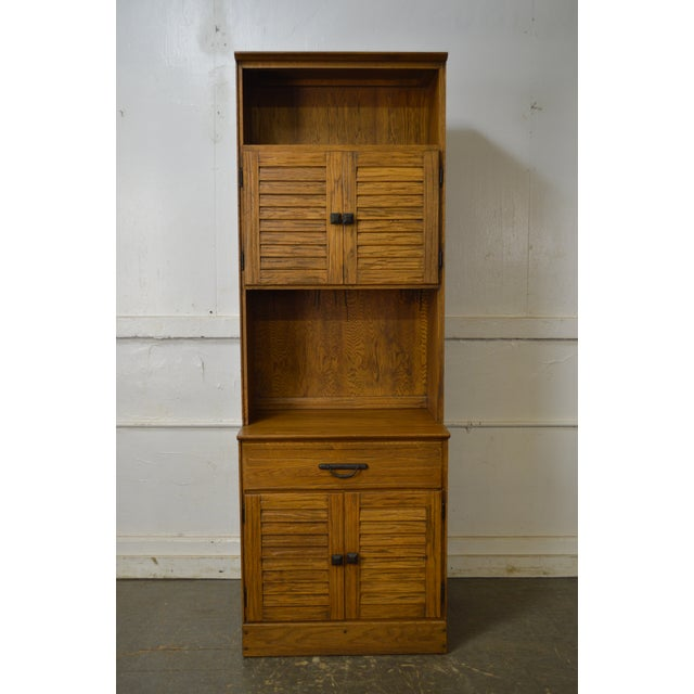 *STORE ITEM #: 17358-fw Brandt Ranch Oak Tall Narrow Bookcase Cabinet w/ Drawer & Doors AGE / ORIGIN: Approx. 50 years,...