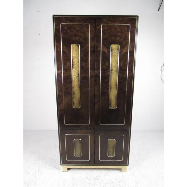 This stunning vintage modern dresser features quality burl walnut construction with mounted acid-etched brass trim....