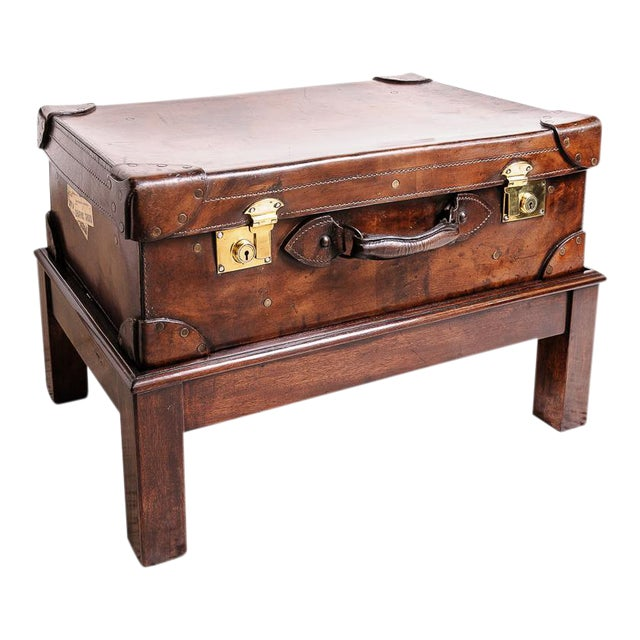 Leather trunk on stand For Sale