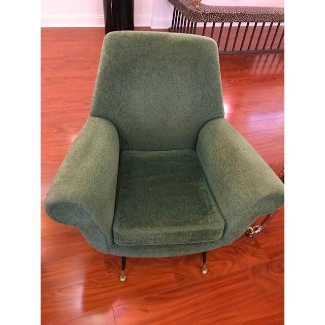 Stunning pair of Italian Mid-Century Modern club chairs. Having ebony legs and green upholstered fabric. Very stylish and...
