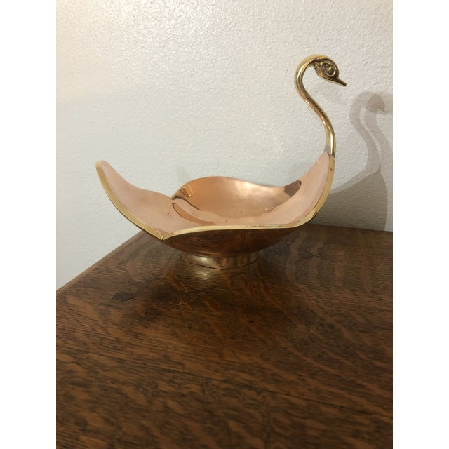 This graceful swan has a gorgeous brass neck and a gleaming copper body trimmed in more brass. The piece is vintage and is...