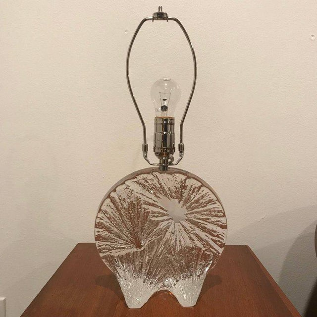 A heavy sculptural carved crystal table lamp made by the famed French crystal maker, Daum. It can be displayed with the...