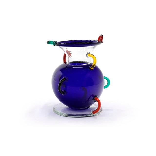 """Early, original Ettore Sottsass """"MIzar"""" vase. Large blue glass with clear glass top and base and multicolored handles...."""