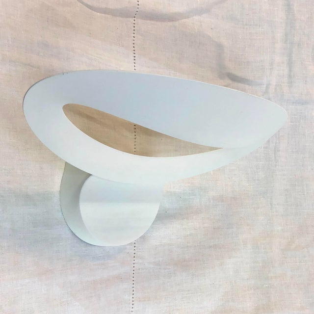 Artemide Mesmeri Wall Sconce in White - Showroom Sample A sleek, open bowl-structured wall sconce. Made of die-cast...