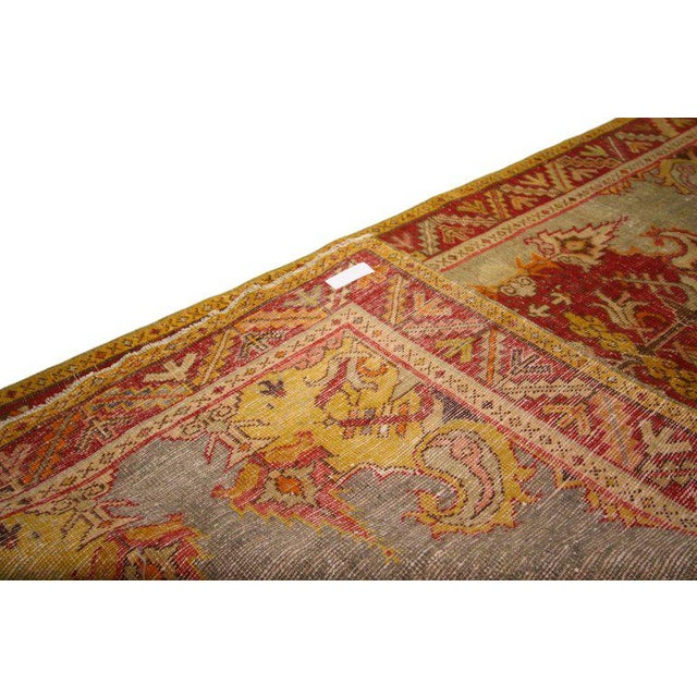 52340, Rustic style distressed vintage Turkish Oushak rug. Marvellously ornamented with a rustic style, this tastefully...